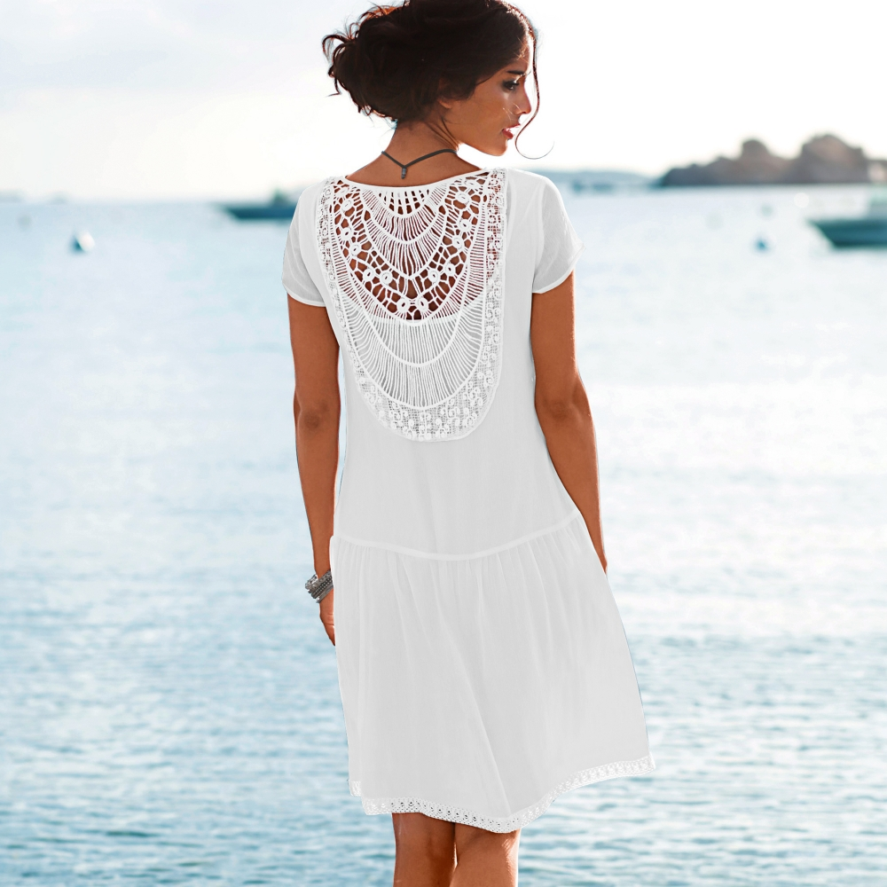 Robe de cocktail blanche porte